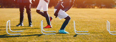 Winter Football Soccer Training Session with Hurdles. Athlete Player Practice Hurdle Jump Banque d'images