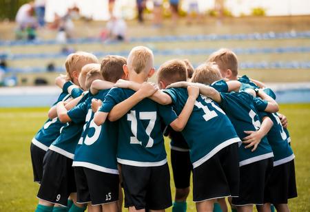Kids football team building team spirit. Soccer children team in huddle. Group of boys united before the final soccer match Stok Fotoğraf - 123609050