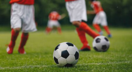 Horizontal Football Background Close-up. FootballSoccer Running with the Ball. Soccer Player Training on the Field. Close-up View of Soccer Ball and Player Leg Stockfoto