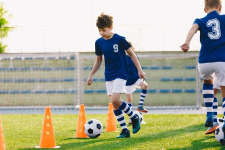 Soccer Drills: The Slalom Drill with Ball. Soccer Football Training Session. Young Boys Practice Slalom Drill. Junior Football Club Training Time