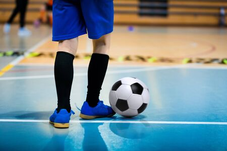 Futsal Junior Player on Indoor Training. Soccer Winter Class at School Indoor Futsal Court. Young Player in an Indoor Play-field