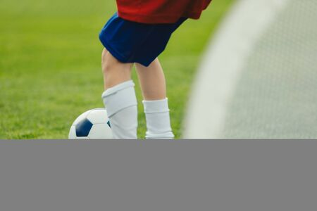 Young Soccer Player Training with Ball