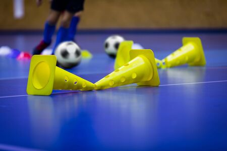 Futsal Indoor Soccer Football Training. Indoor Soccer Training Drill With Cones. Young Players on Futsal Practice. Indoor Physical Education Futsal Unit