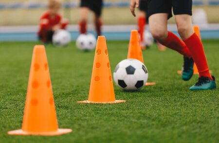 Soccer Training Drill. Football Player Running With Ball. Soccer Athletes Participate in Soccer Practice Drills. Sports Education Background