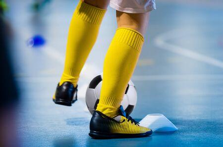 Futsal soccer training. Single young futsal player with ball on training. Close up of legs of futsal footballer. Indoor european football practice unit