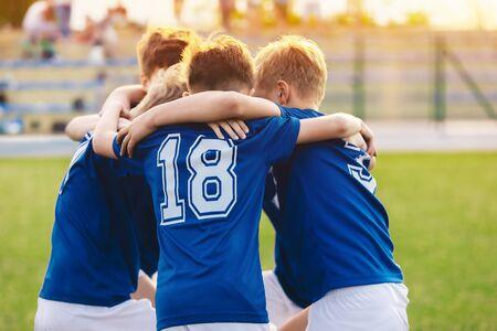 Kids in sports team. Happy boys in football team. Children sports education program. Children football academy
