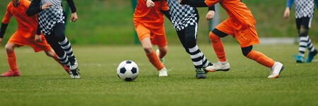 Horizontal Image of Soccer Players Running After Ball and Playing a Football Match