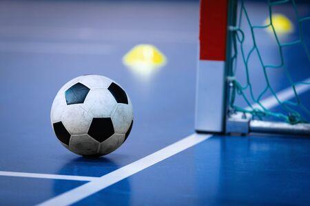 Football futsal ball goal and floor. Indoor soccer sports hall. Sport Futsal background. Indoor Soccer Winter League 版權商用圖片