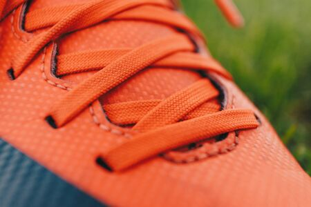 Close-up image of sports cleats. Red sports cleats u designed for field sports such as soccer, football, and baseball 版權商用圖片
