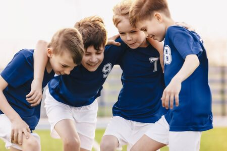 Children Football Team Players. Happy Sports Boys in a School Team. Kids Huddling in a Team on Tournament Competition. Players Gathering Together in a Circle. Kids in Soccer Sportswear
