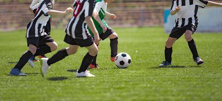 Kids Play Soccer Game. Children Outdoor Football Tournament Match on Grass Field Standard-Bild
