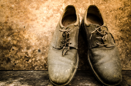 biology backgrounds: still life with boots on wooden table over grunge background
