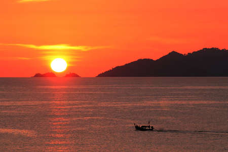 southern of thailand: sunset and boats, southern thailand Stock Photo