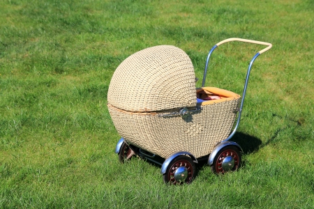 Vintage child buggy for dolls Stock Photo
