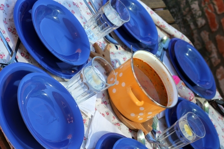 Dinner table with blue dishes and soup photo