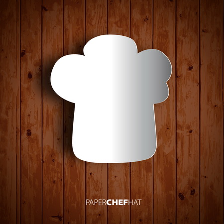 wooden hat: Papercut chef hat on wooden background.