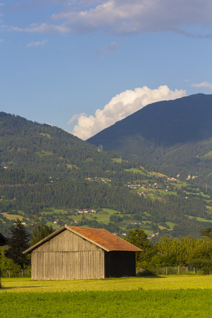 dandelion snow: Austrian landscape with wooden house in the summertime Stock Photo