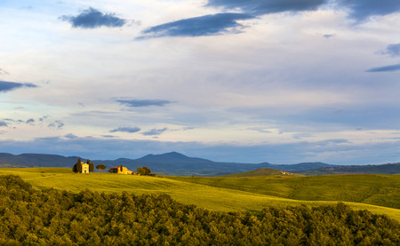 Tuscany landscape at sunset with a little chapel of Madonna di Vitaleta, San Quirico d'Orcia, Italy