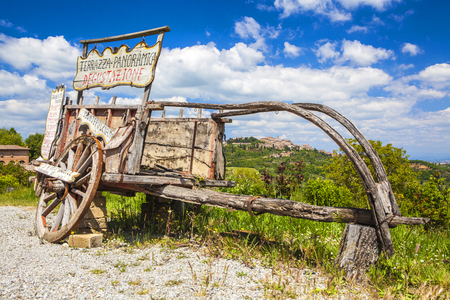 Montepulciano landscape view with old wooden buggy, Ancient small town in Tuscany, Italy