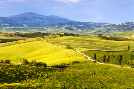 Tuscany, Landscape panorama vith typical villa, magical clouds,Toscana - Italy