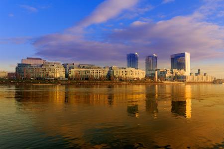 Bratislava modern skyscapers, near Danube river, gold reflection, winter morning, Slovakia