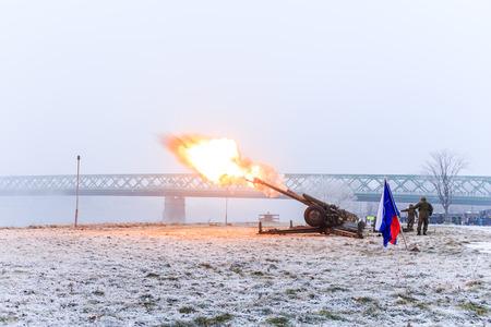 Canon army fire near Promenade in Bratislava park in a snowy winter day, Old bridge, Slovakia