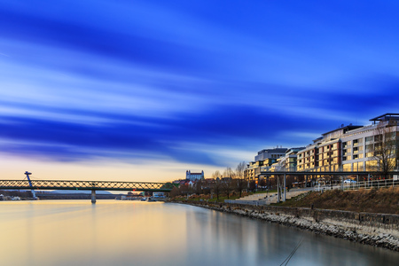 View from harbour at sunset, Bratislava castle, business buildings and river Danube, Long exposure, Slovakia 写真素材