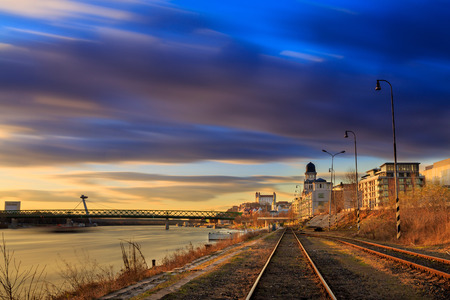 View from harbour at sunset, Bratislava castle, business buildings and river Danube, Long exposure, Slovakia 報道画像