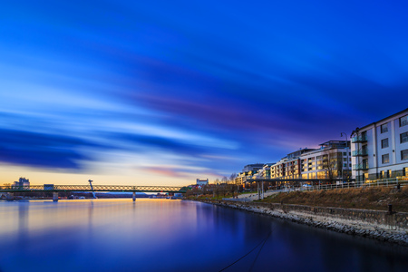 View from harbour at sunset, Bratislava castle, business buildings and river Danube, Long exposure, Slovakia 版權商用圖片