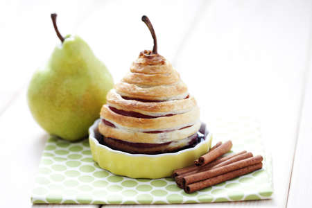 french pastry: delicious pear in french pastry with red wine - sweet food