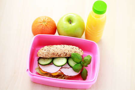 lunch box: box with delicious sandwich and some fruits - food and drink Stock Photo