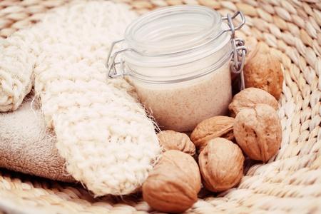 body scrub: walnut body scrub with massage glove - beauty treatment Stock Photo