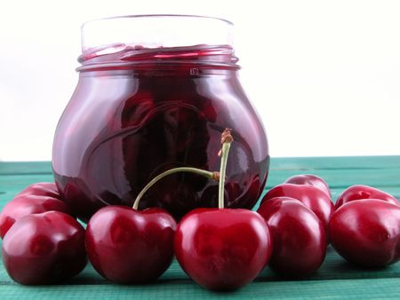 jar of cherry jam and some cherries on green Stock Photo - 443561