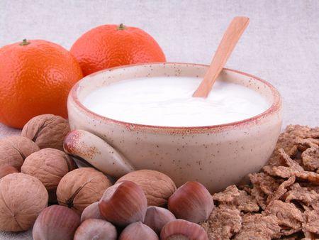 on diet - yogurt hazelnuts cornflakes and tangerines Stock Photo - 471529