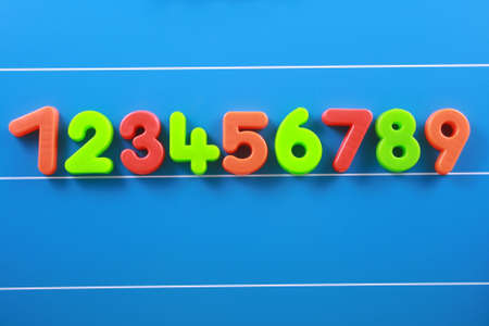 close-ups of colorful number on blue board photo