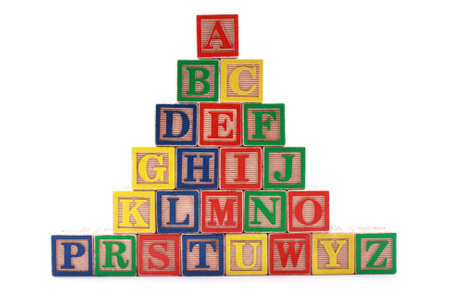 wooden blocks with colorful letters isolated on white photo