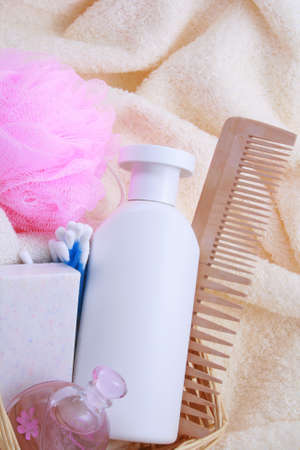 beauty accessories - towel soap parfume bottle of shampoo in basket Stock Photo - 807581