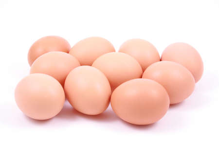 lots of fresh eggs isolated on white