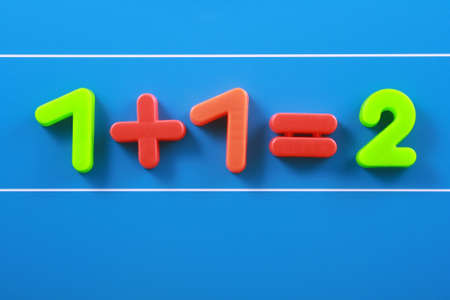 close-ups of colorful number on blue board - education