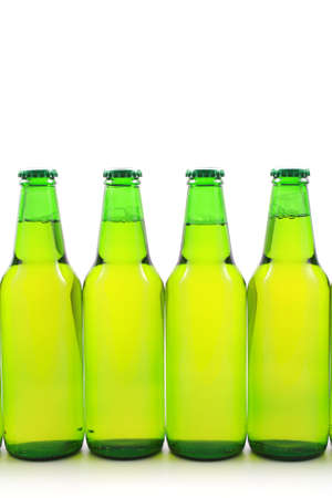 four bottles of beer isolated on white photo