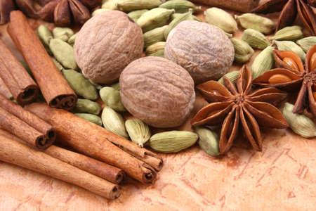 close-ups of various spices - nutmeg cinnamon cardamom anise photo