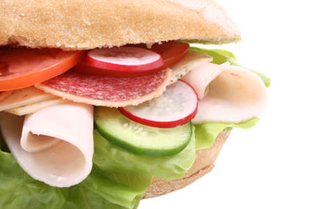 delicious sandwich with cheese ham and vegetables isolated on white photo