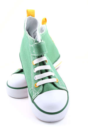 pair of green sneakers for children isolated on white Stock Photo