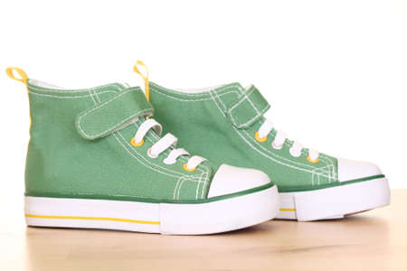 pair of green sneakers for children on the floor photo