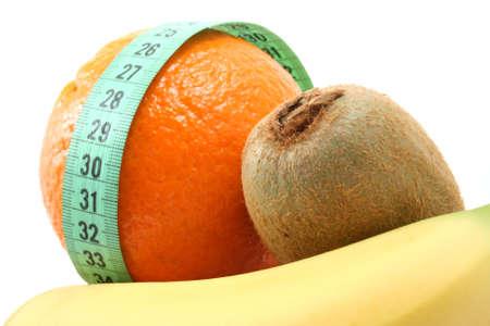 light snack on diet - banana orange and kiwi isolated on white Stock Photo - 960136