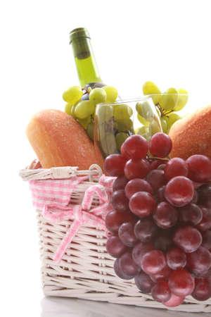 picnic basket full of food isolated on white photo
