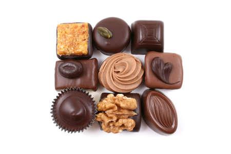 close-ups of mixed chocolates isolated on white