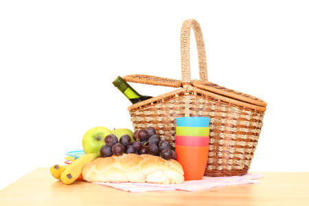 picnic basket and food ready to pack isolated on white