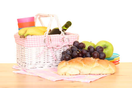 picnic basket and food ready to pack isolated on white photo