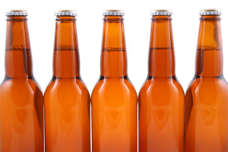 five bottles of beer isolated on white photo